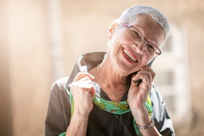Optical Brand Emotional Story Telling Woman with new glasses on phone