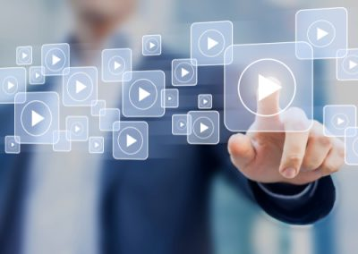 Man about to press video play, video marketing